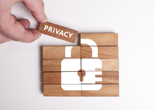 Business, Technology, Internet And Network Concept. Young Businessman Shows The Word: Privacy