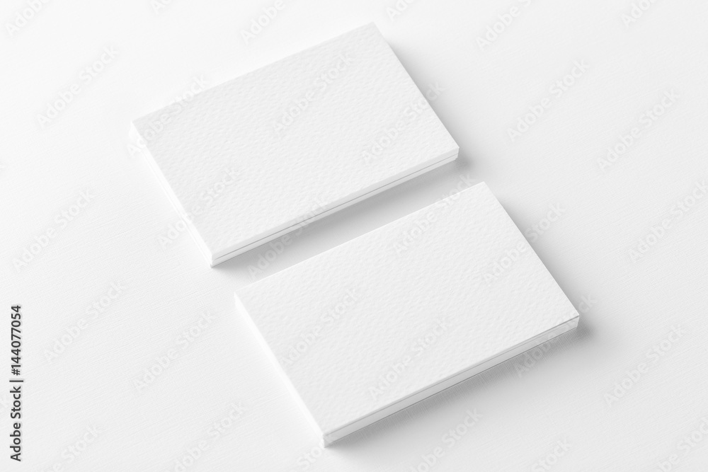 Fototapety, obrazy: Mockup of two horizontal business cards stacks at white textured background. Angle view