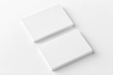 Mockup Of Two Horizontal Business Cards Stacks At White Textured Background. Angle View