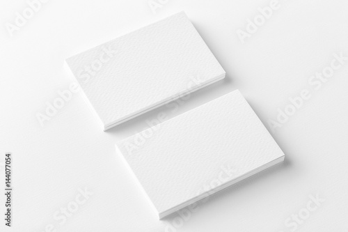 Valokuva Mockup of two horizontal business cards stacks at white textured background