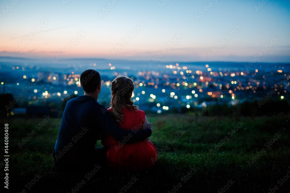 Fototapety, obrazy: Lovers against the background of a night city, night starry sky and horizon. Concept is a romantic date, the first love
