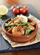 Fresh jumbo shrimps and green asparagus, delicious dish or meal, close-up shot. Spanish Tapas.