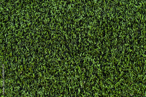 Photo Plastic green grass. Football turf