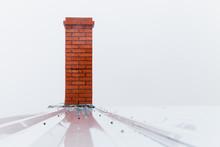 Chimney Made Of Red Bricks Over White Sky