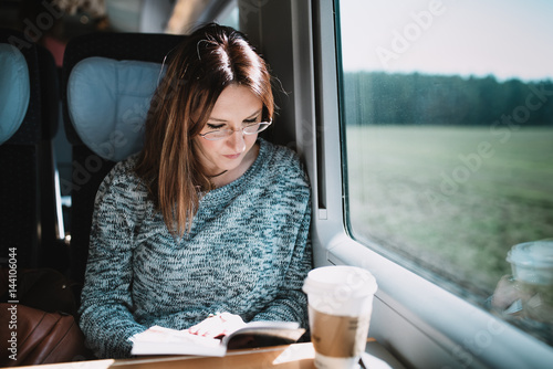 Reading book on the train