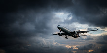 View From The Beach On The Landing Airplane Isolated Over Beautiful Cloudy Dramatic Looking Sky Background