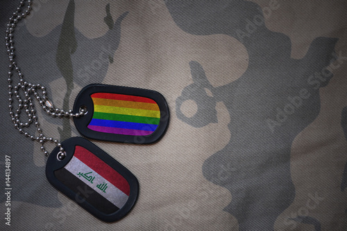 Stampe  army blank, dog tag with flag of iraq and gay rainbow flag on the khaki texture background