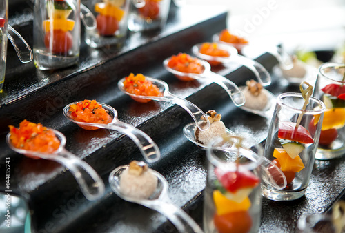 Foto auf Leinwand Bar catering services background with snacks on guests table