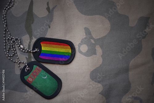 Stampa su Tela  army blank, dog tag with flag of turkmenistan and gay rainbow flag on the khaki texture background