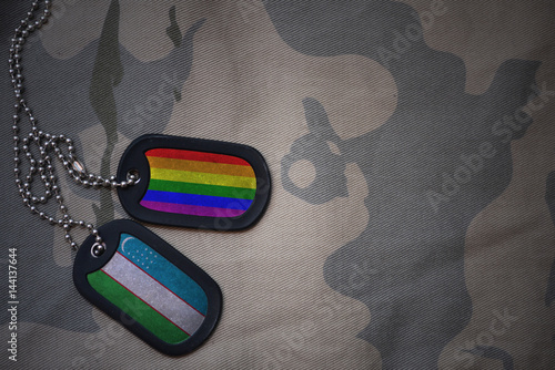 Stampe  army blank, dog tag with flag of uzbekistan and gay rainbow flag on the khaki texture background