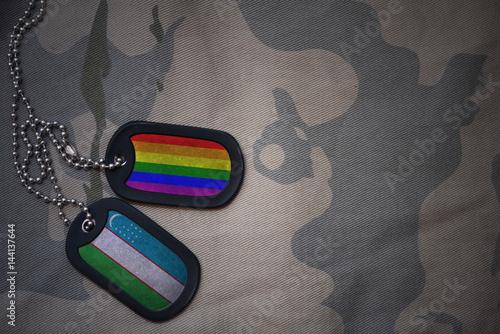 Stampa su Tela  army blank, dog tag with flag of uzbekistan and gay rainbow flag on the khaki texture background