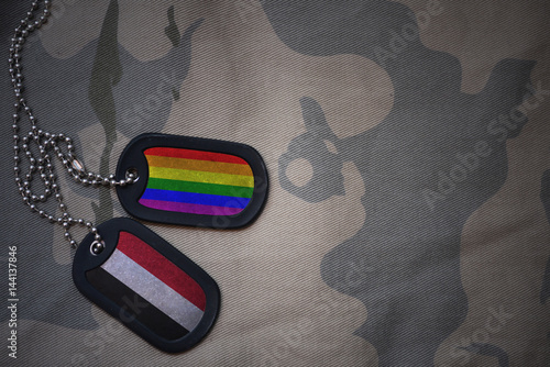 Stampa su Tela  army blank, dog tag with flag of yemen and gay rainbow flag on the khaki texture background