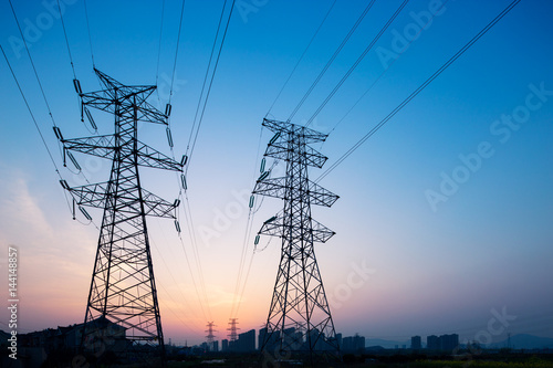 pylons in blue sky at sunrise