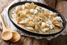 Delicious Clams In A Creamy Sauce With Parsley Closeup On A Plate. Horizontal