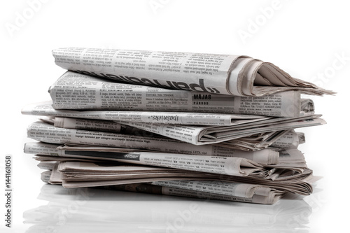 newspaper stack isolated on white background
