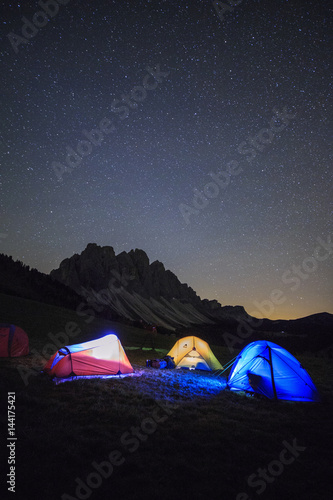 Foto op Canvas Kamperen Camping under the stars. Malga Zannes Funes Valley South Tyrol Dolomites Italy Europe