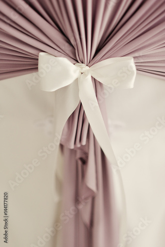 Valokuva  white bow on a white wedding decoration in the banquet room