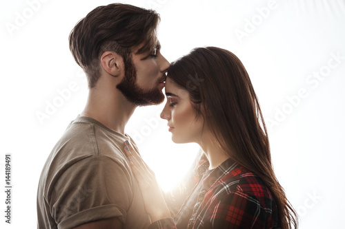 When a man kisses a woman on the forehead