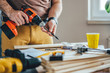 Leinwanddruck Bild - Man using cordless drill