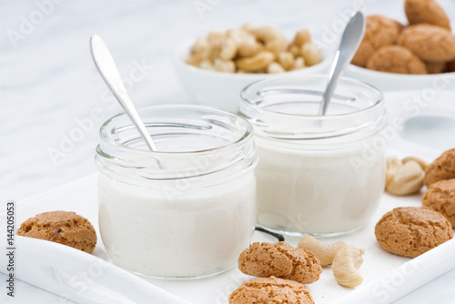 Cadres-photo bureau Produit laitier nut yogurt and sweet biscuits for healthy breakfast, closeup