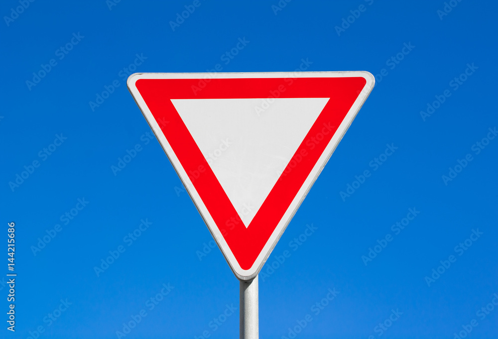 Fototapety, obrazy: Give way / Yield - red and white triangle. Clear blue sky is behind road sign.