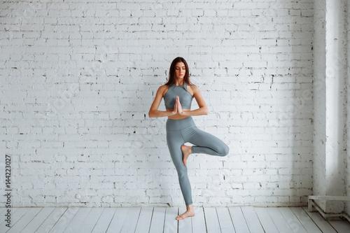 Fotografie, Obraz  Young woman doing yoga, tree pose