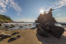 A Huge Sandy Beach With Large Stones.  Beautiful Blue Sea. Redwood National And State Parks. California, USA