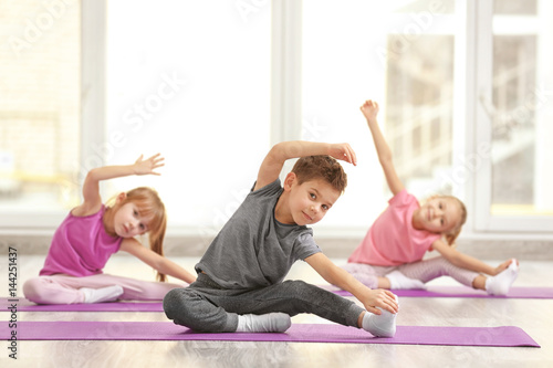 Spoed Foto op Canvas Gymnastiek Group of children doing gymnastic exercises