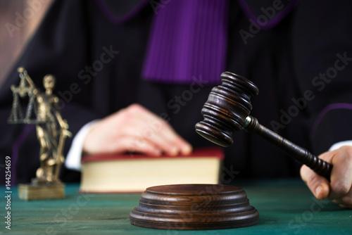 Billede på lærred Law concept,Judge In A Courtroom Striking The Mallet