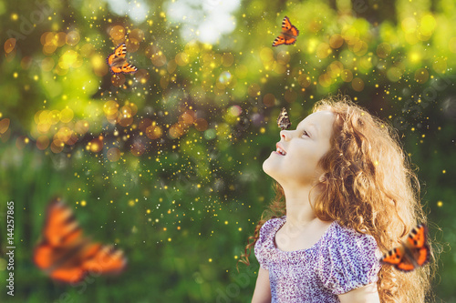 Fotografie, Obraz  Cute child girl with a butterfly on his nose
