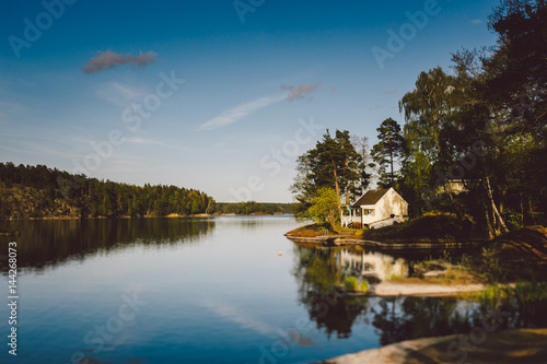 Foto op Canvas Meer / Vijver white wooden house on the lake