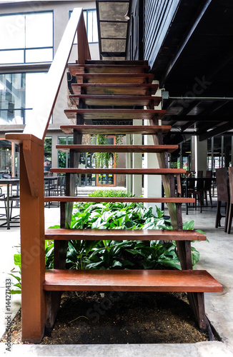 Wooden stairs at the outside of restaurant, interior or modern