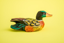 Hand Made Wooden Ducks For Home Decoration On Yellow Background