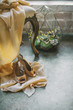 Bride`s boidoir, details of her peignoir and shoes on a chair, loft studio