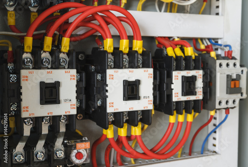 Close-up electrical wiring with fuses and contactors in ... on