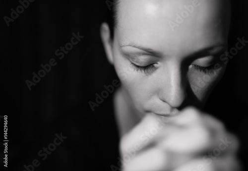 Fototapeta Portrait of woman praying and feeling desperate.