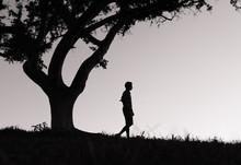 Young Man Walking Alone Outdoo...
