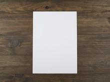 Blank Sheet On Brown Wooden Ta...