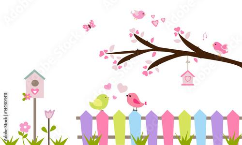Photo Rama de árbol, valla, pájaros y flores.