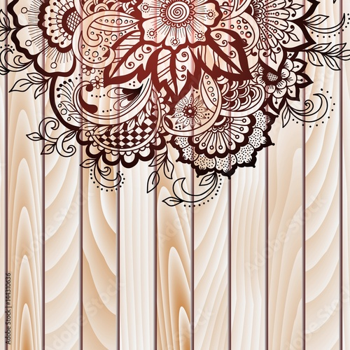 Fotografía  Vector abstract floral elements in Indian mehndi style on wooden background