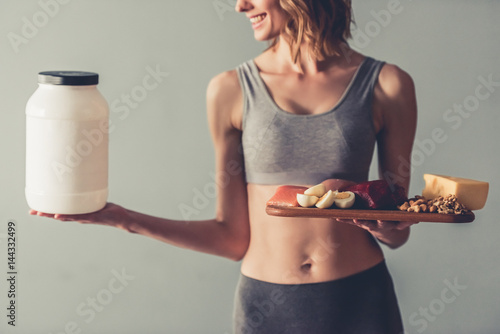 Woman with sport nutrition Wallpaper Mural