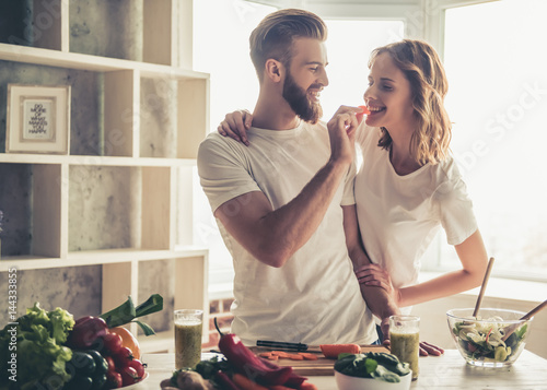 Couple cooking healthy food Canvas Print