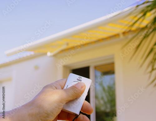 Fotografie, Obraz  store banne électrique ,ouverture avec télécommande