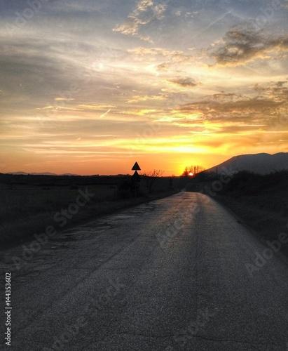 Poster Cappuccino Sulla strada al tramonto
