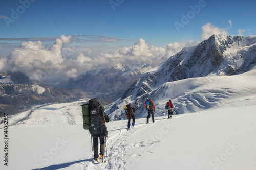 A group of climbers descends to the base camp, Pamir Wallpaper Mural