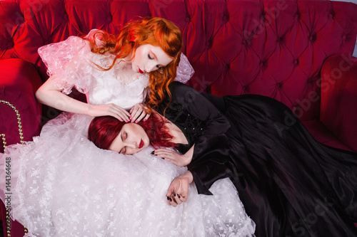 Fotografie, Tablou  Two girls with red hair in retro dress in the bedroom