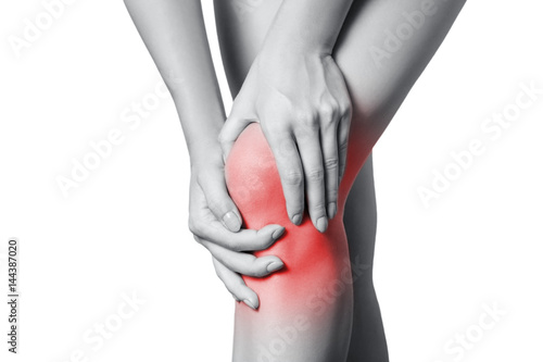 Fotografiet  Closeup view of a young woman with knee pain