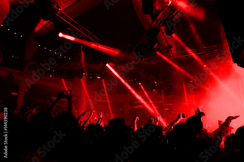 Foto Night club dj party people enjoy of music dancing sound with colorful light with Smoke Machine and lights show