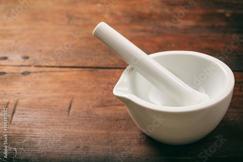 Mortar and pestle on wooden background Canvas Print