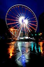 Night Shot In The Rain Of A Ferris Wheel In Atlanta, Georgia.